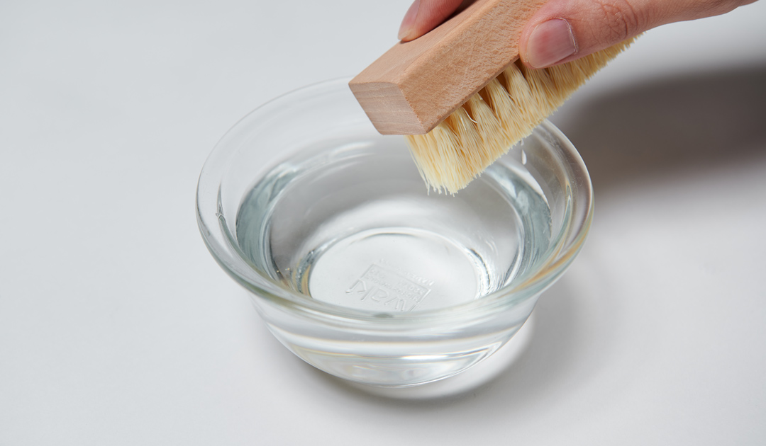 Dip your premium brush into a bowl of water.